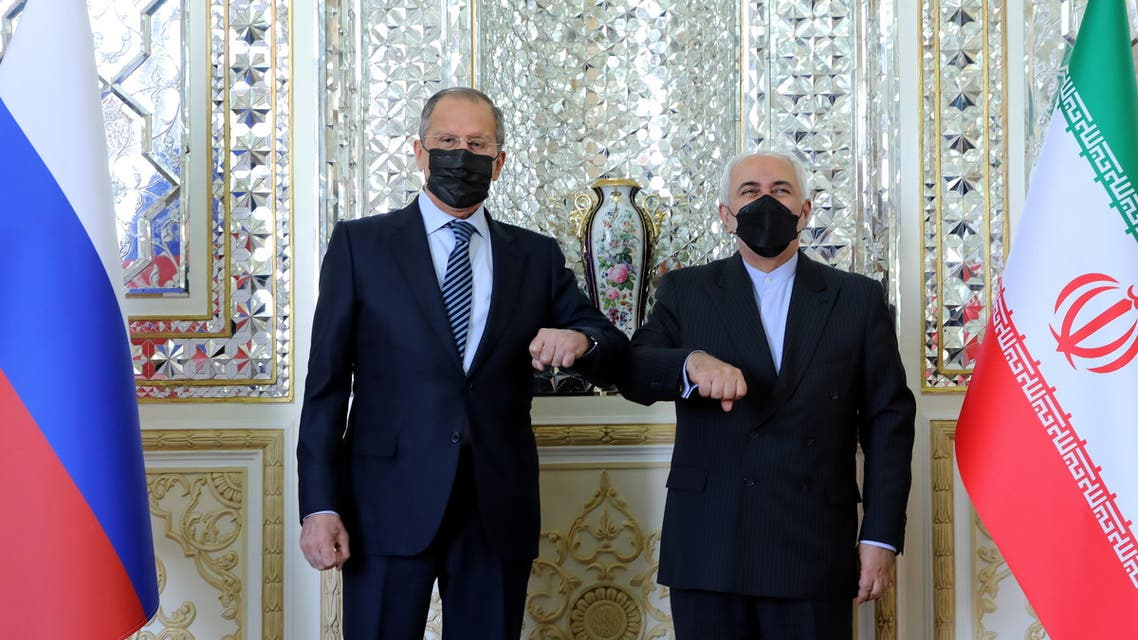 Iran's Foreign Minister Mohammad Javad Zarif and Russia's Foreign Minister Sergei Lavrov bump elbows while meeting in Tehran, Iran. (Reuters)