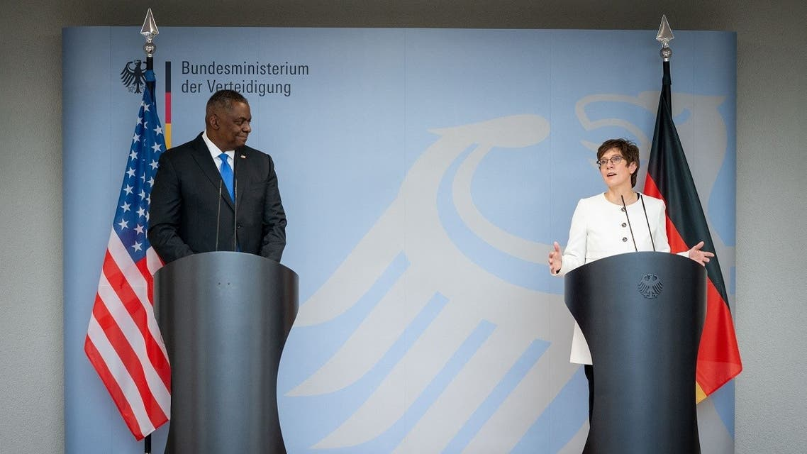 German Defence Minister Annegret Kramp-Karrenbauer (R) and US Defence Secretary Lloyd Austin address a joint press conference after a meeting in Berlin, on April 13, 2021. (AFP)