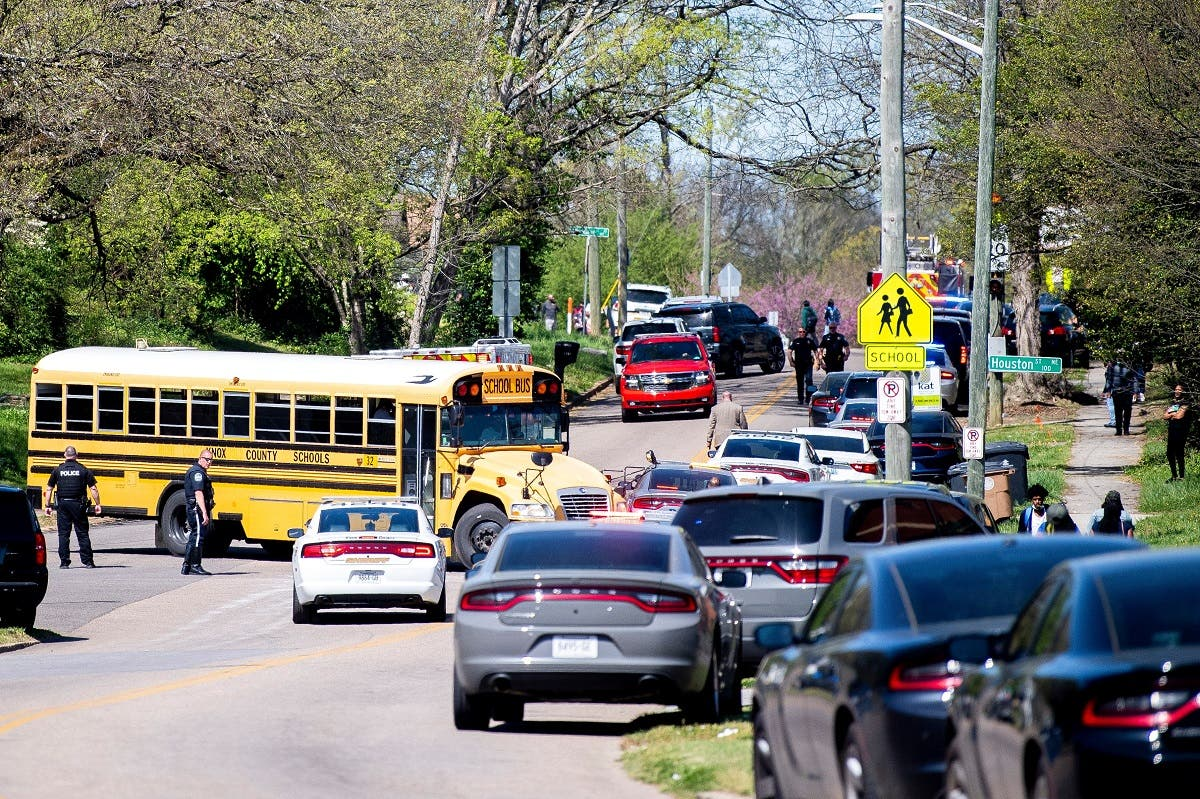 Police attend a shooting at Austin-East Magnet High School in Knoxville, Tennessee, April 12, 2021. (Reuters)