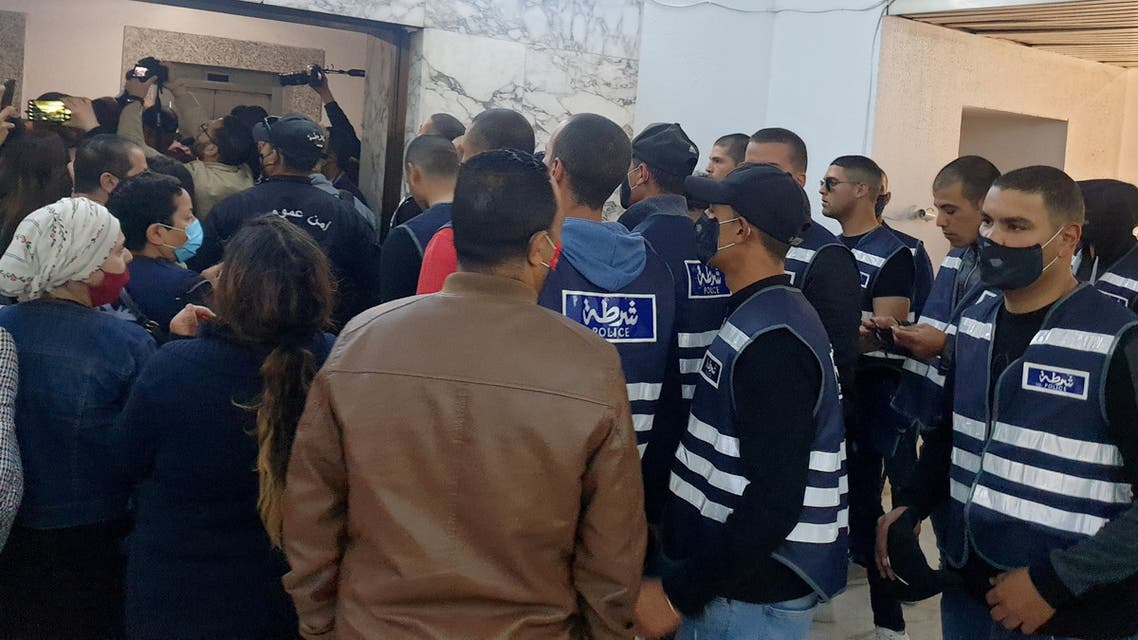 Police members attempt to disperse journalists at the state news agency, demonstrating against a new chief executive whose appointment they see as an attempt to undermine editorial independence, in Tunis, Tunisia April 13, 2021. REUTERS/Tarek Amara
