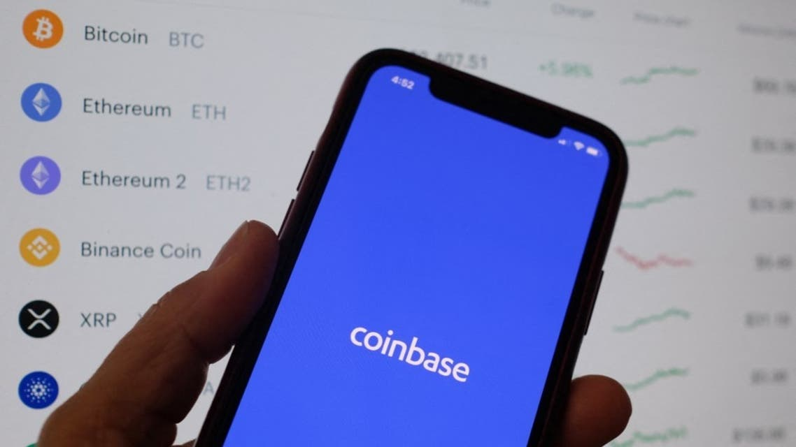 This illustration photo shows the Coinbase logo on a smartphone in Los Angeles on April 13, 2021. (AFP)