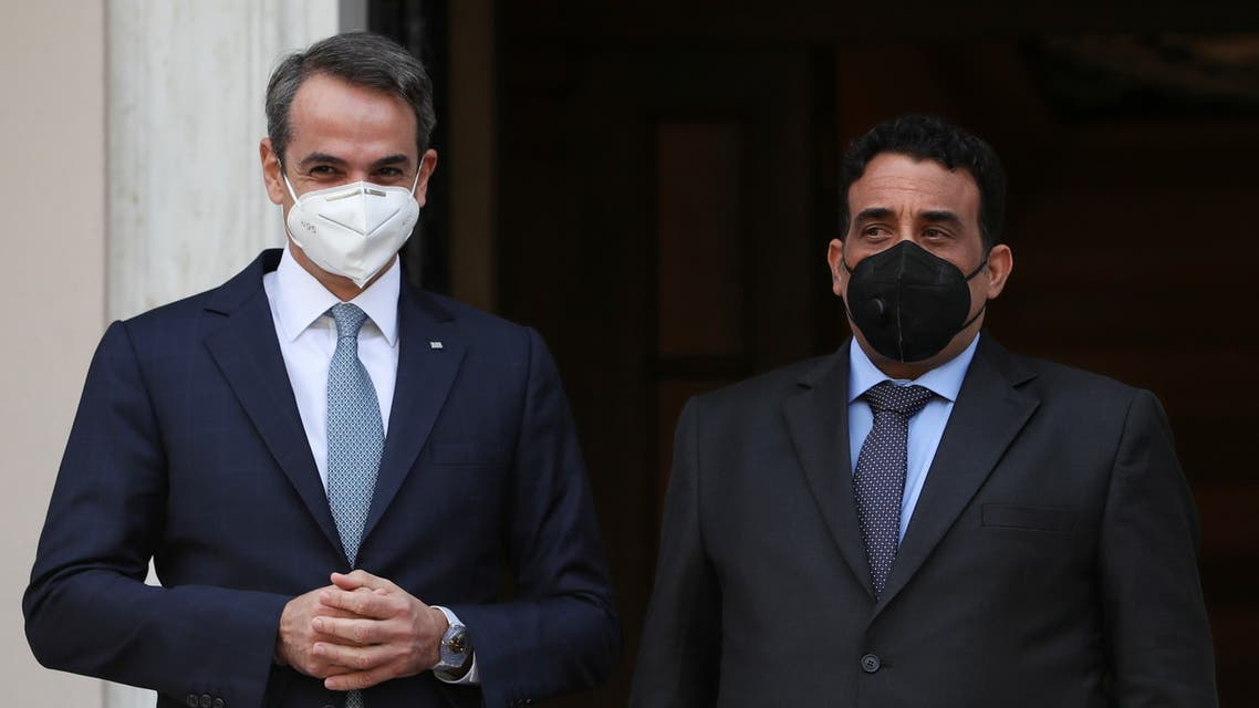 Greek Prime Minister Kyriakos Mitsotakis welcomes the head of the Presidential Council of Libya Mohamed al-Menfi at the Maximos Mansion, in Athens, Greece, April 14, 2021. REUTERS/Costas Baltas