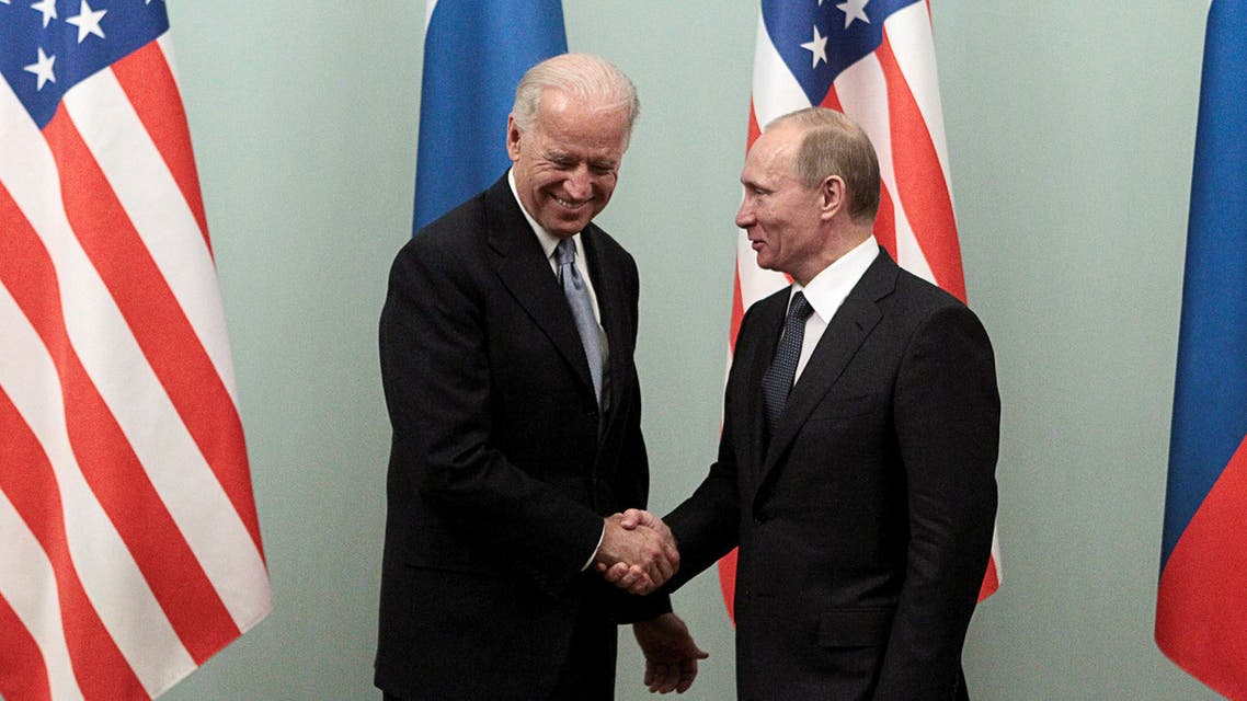 Russian Prime Minister Vladimir Putin (R) shakes hands with then-US VP Joe Biden (L) on March 10, 2011 during their meeting in Moscow. (AFP)