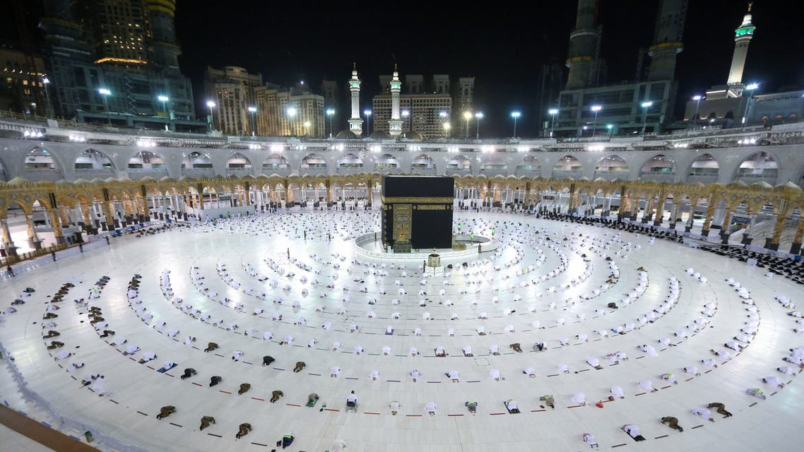 Muslim worshippers gather for prayers around the Kaaba, the holiest shrine in the Grand mosque complex in the Saudi city of Mecca during the first day of the Muslim holy fasting month of Ramadan on April 13, 2021. (AFP)
