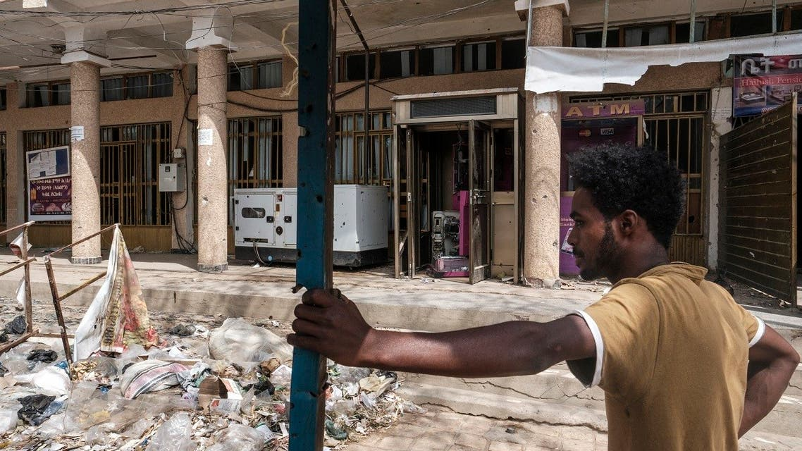 A man stands in front of a bank which was allegedly looted by Eritrean forces, in Wukro, north of Mekele, on March 1, 2021. (AFP)