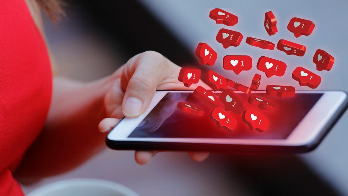 Women holding mobile phone with social media notification icon stock photo