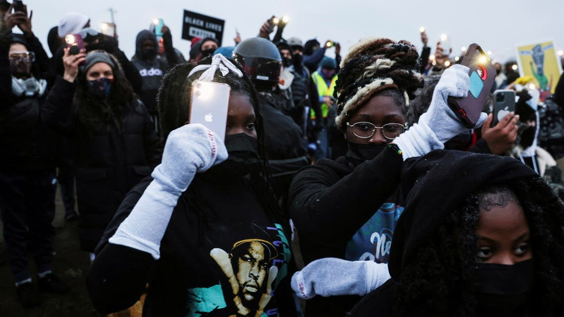 Princess Kuiah (front L), 15, Edwina Kulee, 17, and Praise Cole (front R), 15, take part in a rally outside the Brooklyn Center Police Department, days after Daunte Wright was shot and killed by a police officer, in Brooklyn Center, Minnesota, U.S. April 13, 2021. REUTERS/Leah Millis