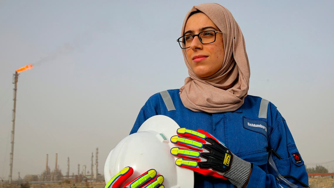 Zainab Amjad, a petrochemical engineer, poses for a photo near an oil field outside Basra, Iraq, Monday, Feb. 18, 2021. Amjad is among just a handful of women who have eschewed the dreary office jobs typically handed to female petrochemical engineers in Iraq. Instead, they chose to become trailblazers in the country's oil industry, taking up the grueling work of drilling. (File photo: AP)
