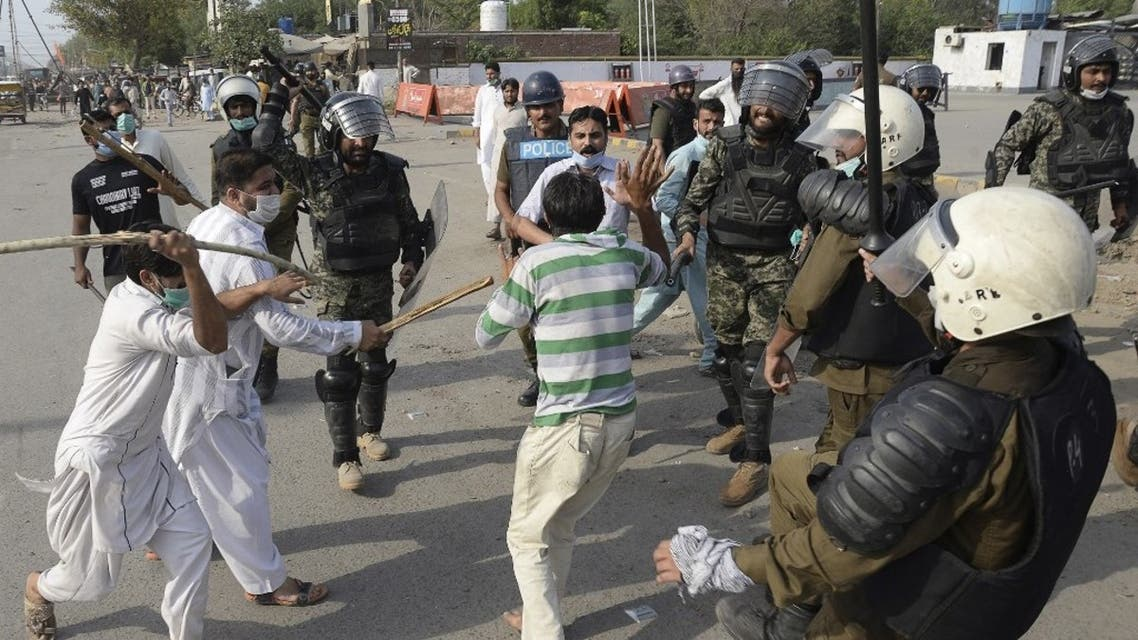 Policemen beat a supporter of Tehreek-e-Labbaik Pakistan (TLP) party during a protest against the arrest of their leader as he was demanding the expulsion of the French ambassador over depictions of Prophet Muhammad, in Lahore on April 13, 2021. (AFP)