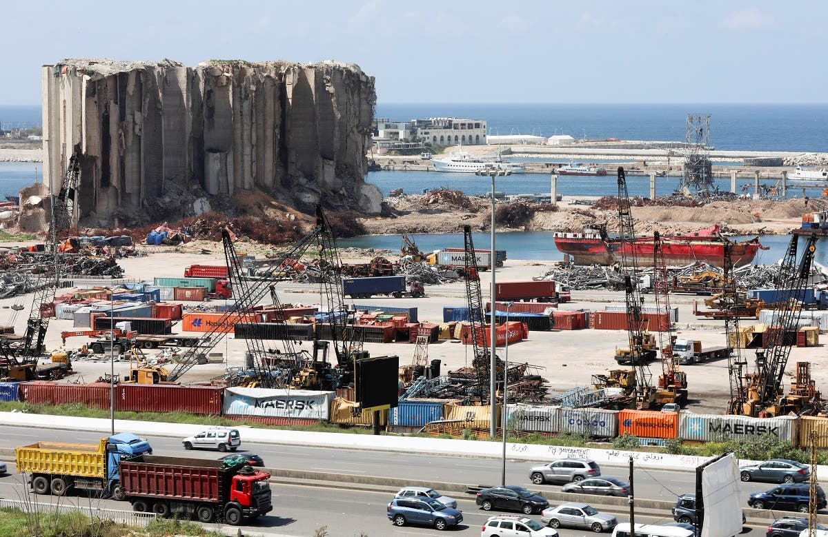 Vehicles drive near the grain silo that was damaged during Beirut port explosion, in Beirut, April 9, 2021. (Reuters)