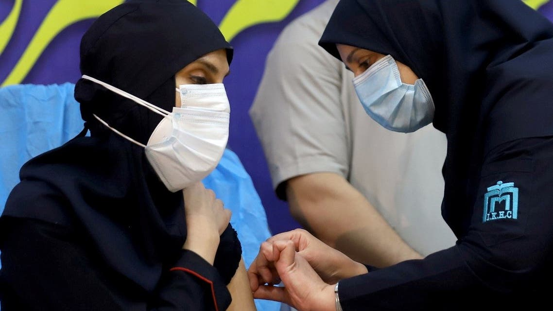 A member of the Imam Khomeini Hospital medical personnel receives a dose of Russia's Sputnik V vaccine against the coronavirus disease (COVID-19), in Tehran, Iran February 9, 2021. (Reuters)