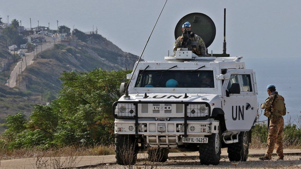 United Nations peacekeeping force in Lebanon (UNIFIL) vehicles patrol the Lebanese southern coastal area of Naqura by the border with Israel, on November 11, 2020. (AFP)