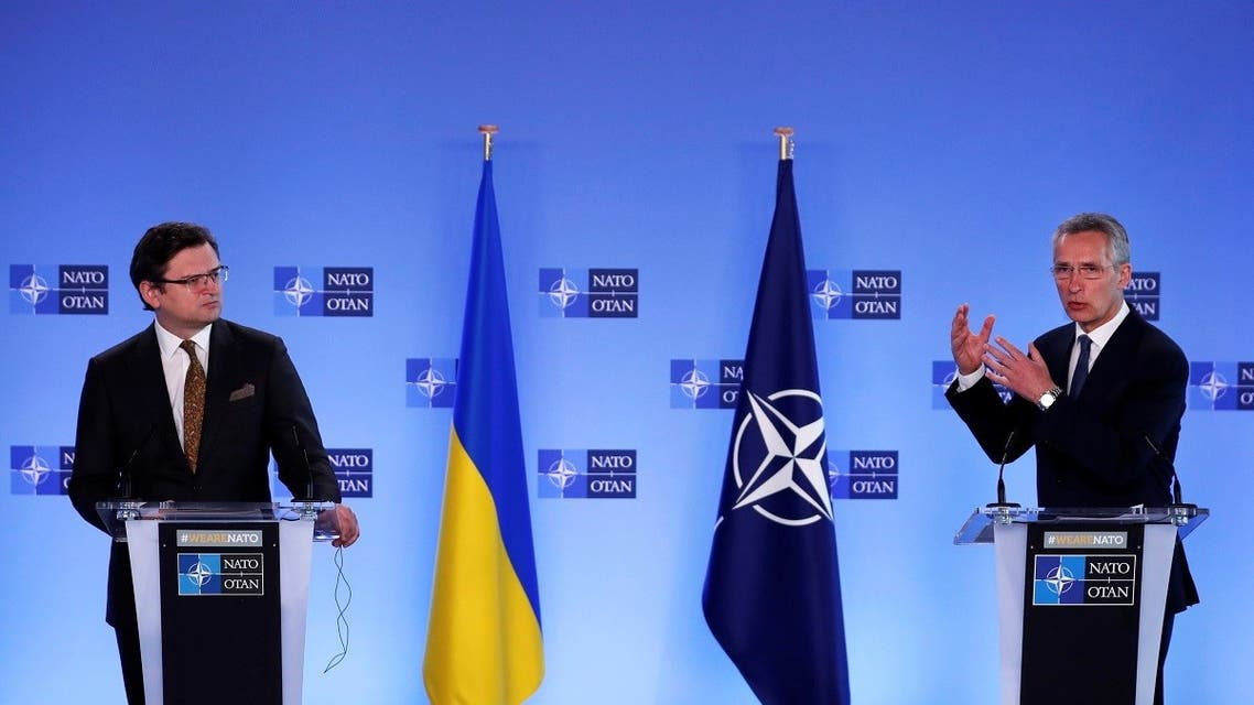 NATO Secretary General Jens Stoltenberg (R) and Ukraine's Foreign Minister Dmytro Kuleba give a press conference following their meeting at NATO headquarters in Brussels, on April 13, 202. (Reuters)