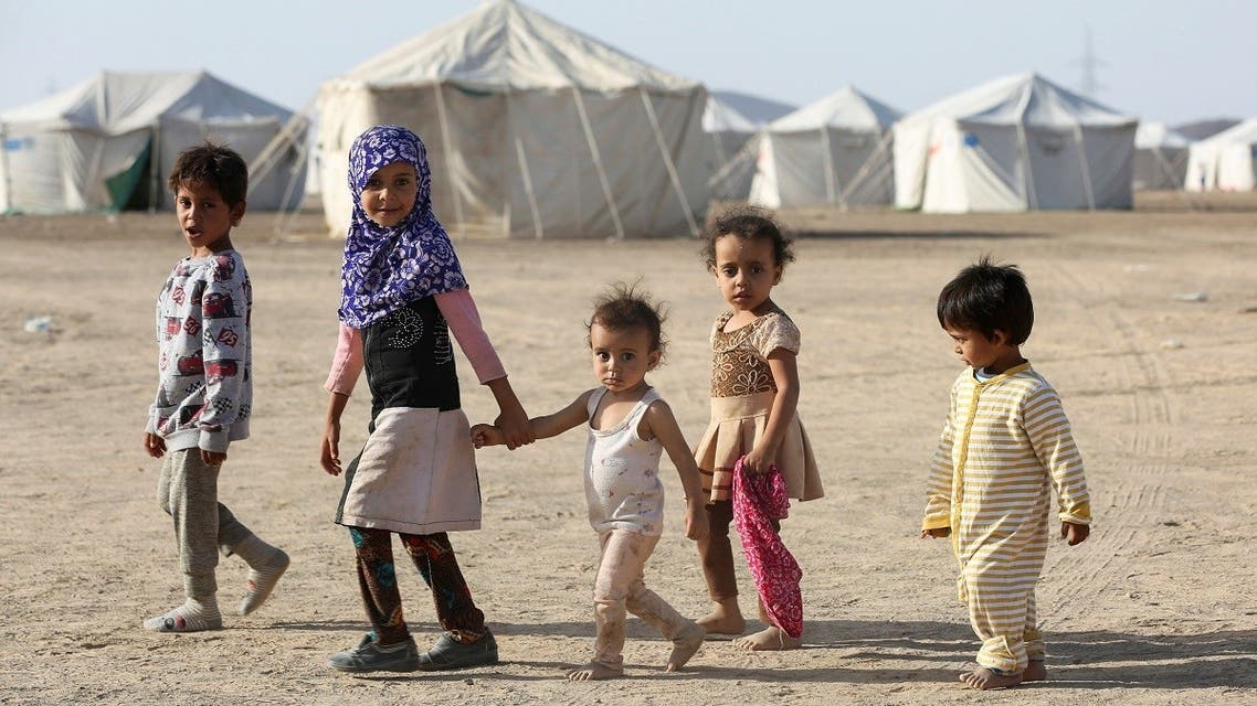 Children walk at a camp for people recently displaced by fighting between government forces and Houthis, in Marib, Yemen March 8, 2020. (Reuters)