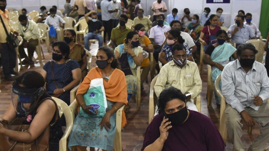 People wait to receive a dose of the Covishield, AstraZeneca-Oxford's Covid-19 coronavirus vaccine in Mumbai on April 10, 2021. (AFP)