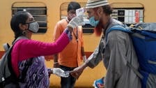 Migrant workers fill Mumbai trains as COVID-19 situation dries up jobs