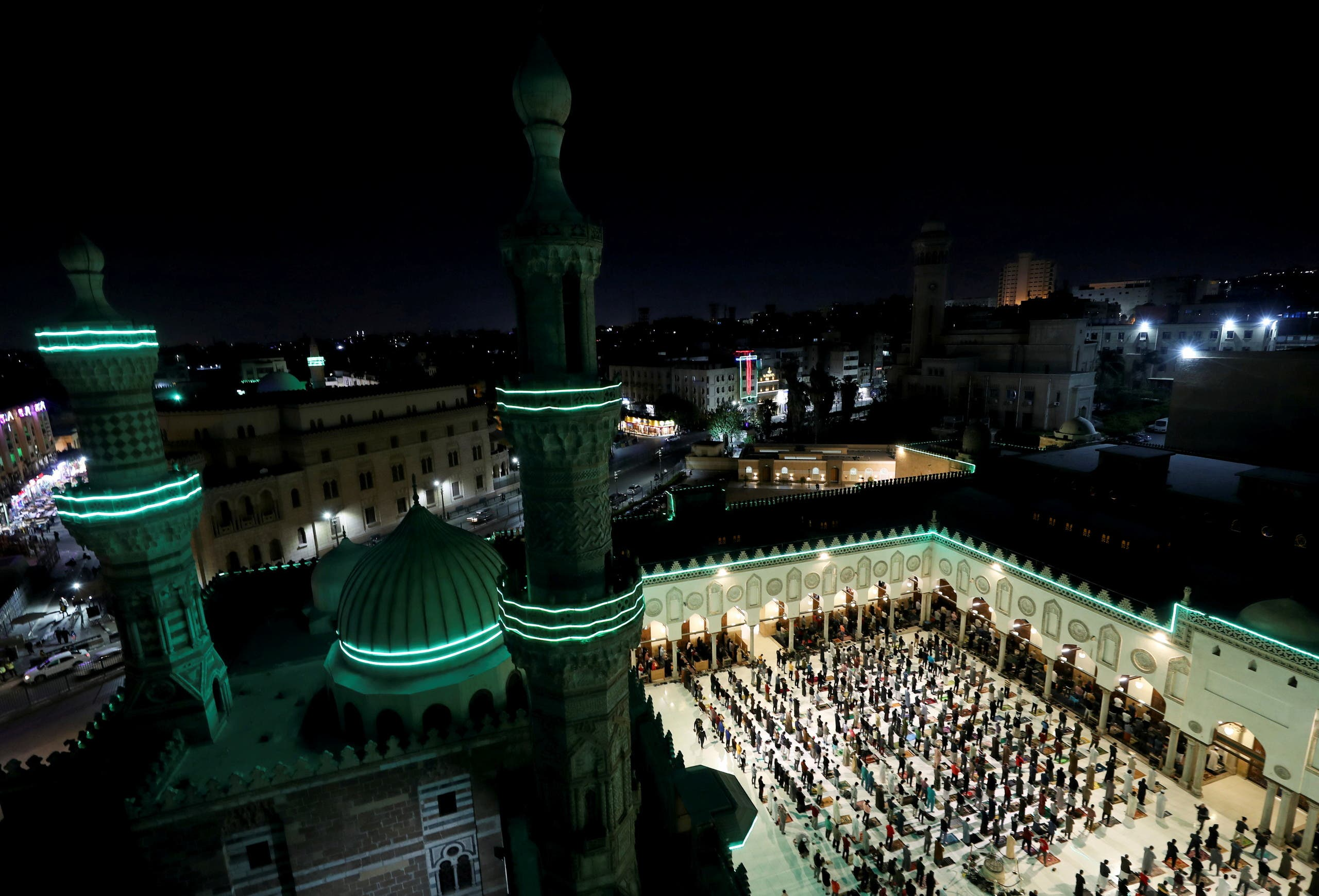 Muslims perform evening Tarawih prayers inside Al-Azhar Mosque on the holy fasting month of Ramadan, amid the coronavirus disease (COVID-19) pandemic in the old Islamic area of Cairo, Egypt, April 13, 2021. (Reuters)
