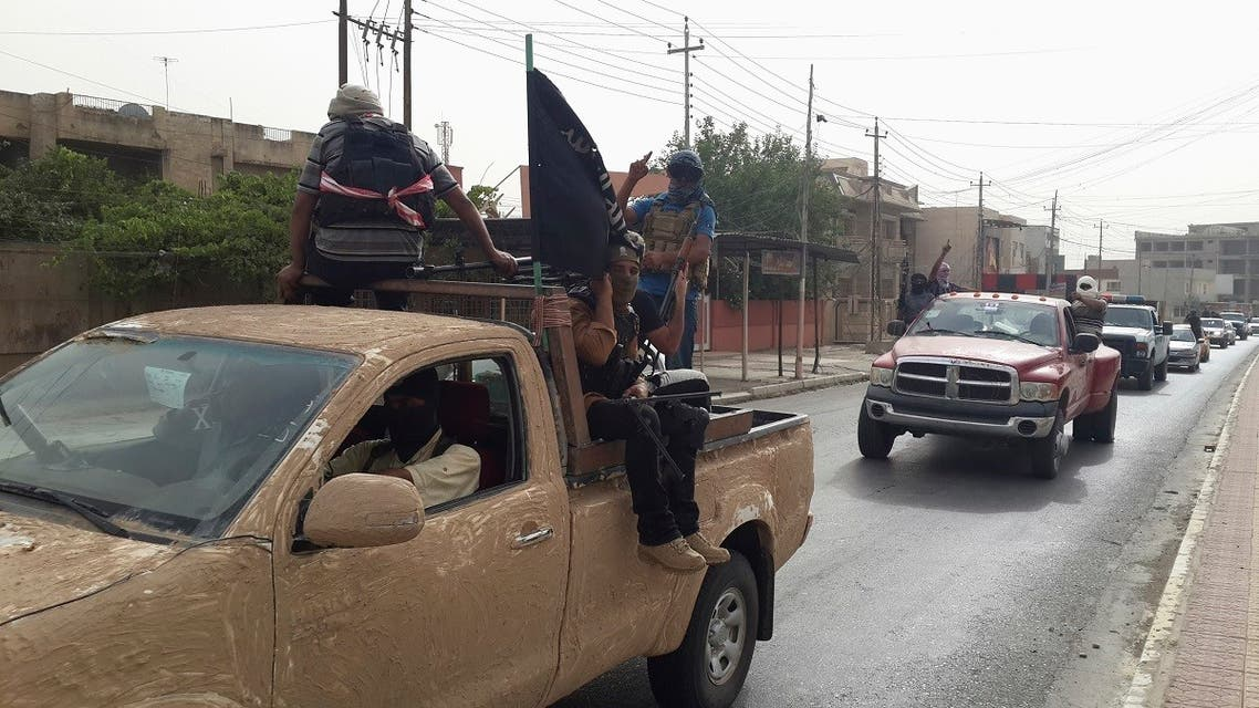 ISIS terrorists celebrate on vehicles taken from Iraqi security forces, at a street in city of Mosul, June 12, 2014. (Reuters)