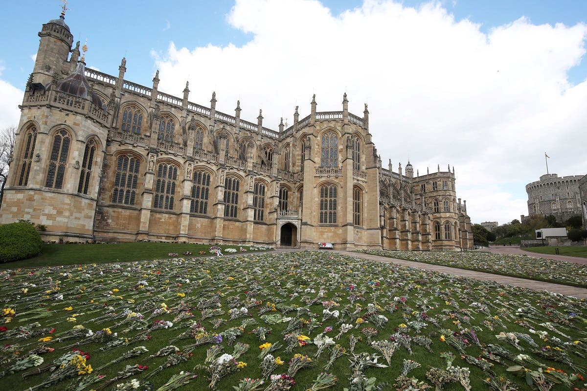 Flowers sit outside St George's Chapel, following the death of Britain's Prince Philip, the Duke of Edinburgh at the age of 99, at Windsor Castle, Berkshire, Britain, on April 16, 2021. (Reuters)