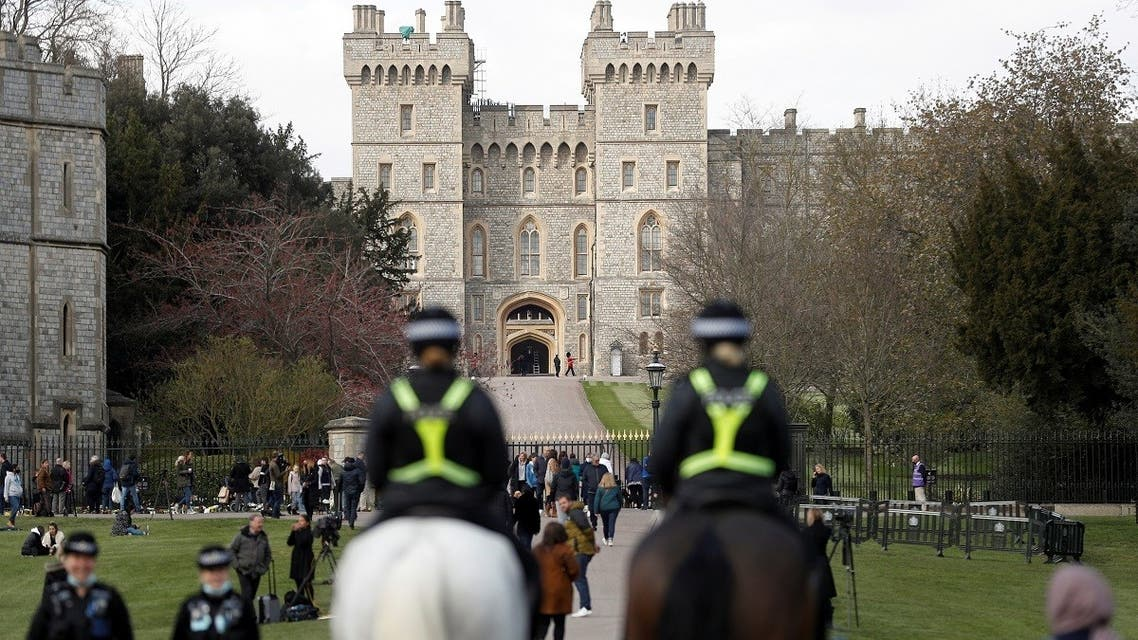 Mounted police officers ride along the Long Walk, near Windsor Castle, after Britain's Prince Philip, husband of Queen Elizabeth II, died at the age of 99, in Windsor, Britain, on April 16, 2021. (Reuters)
