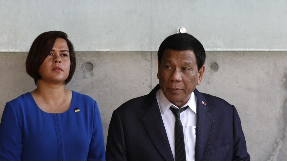 The President of the Philippines Rodrigo Duterte looks on as he sits next to his daughter (L) on September 3, 2018. (AFP)