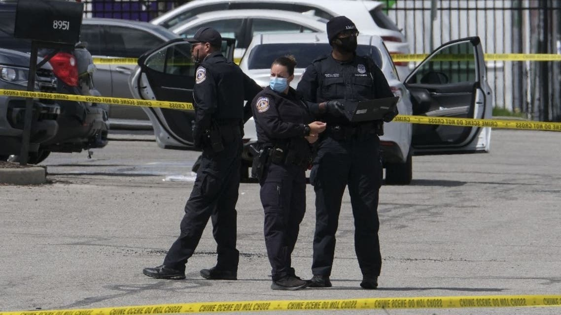 Police officers stand guard outside the site of a mass shooting at a FedEx facility in Indianapolis, Indiana on April 16, 2021. (AFP)