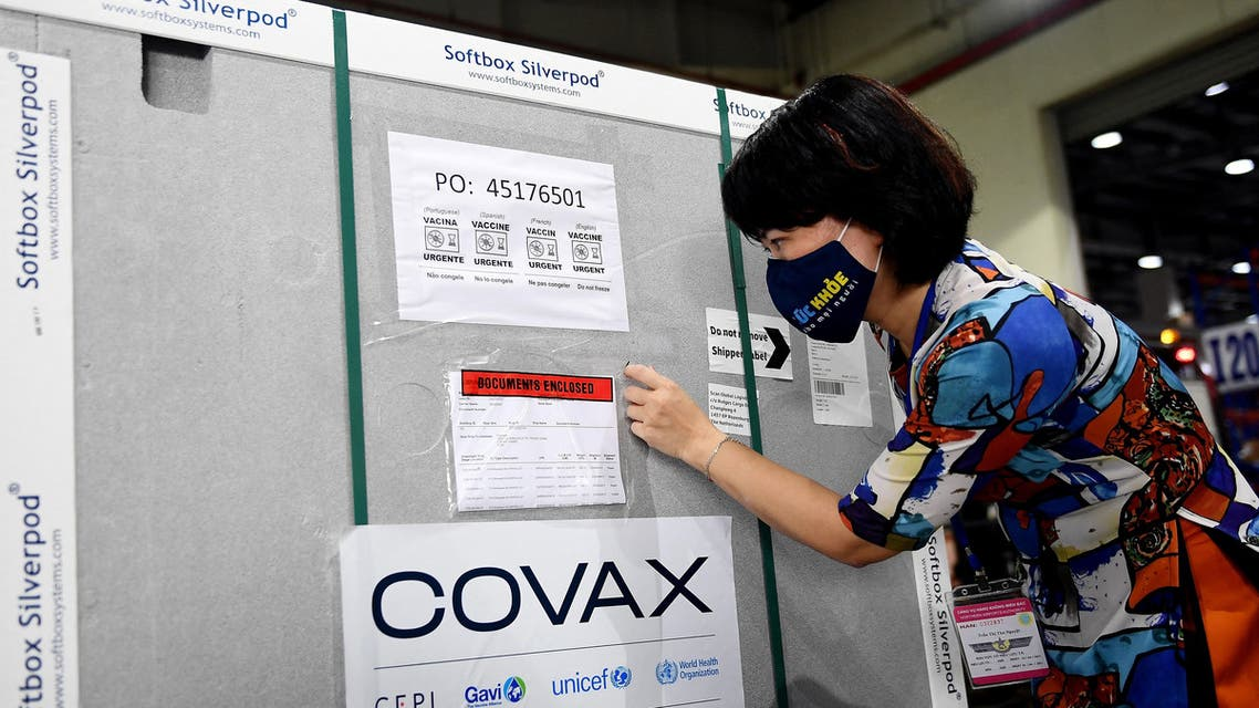 A Health Ministry official checks documents on a container carrying the first shipment of the AstraZeneca/Oxford Covid-19 coronavirus vaccine doses, as part of the UN global Covax programme, as it arrives at the Noi Bai International Airport Cargo terminal in Hanoi on April 1, 2021. (File photo: AFP)
