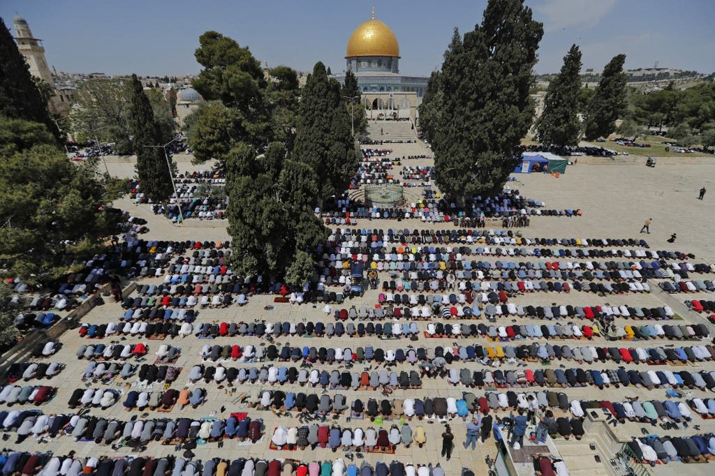 Palestinians take part in the first Friday prayers of the Muslim fasting month of Ramadan, at the Al-Aqsa Mosque compound, Islam's third holiest site, in Jerusalem's Old City, on April 16, 2021. (AFP)
