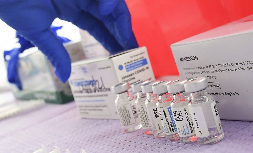 Bottles of the single-dose Johnson & Johnson Janssen Covid-19 vaccine await transfer into syringes for administering at a vaccine rollout targetting immingrants and the undocumented in Los Angeles, California on March 25, 2021. (AFP)
