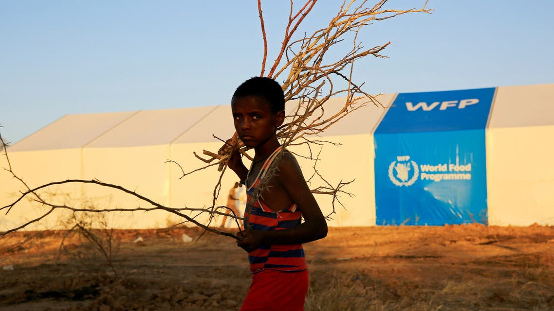 An Ethiopian refugee fleeing from the ongoing fighting in Tigray region, walks past a world food program tent, at the Um-Rakoba camp, on the Sudan-Ethiopia border, in the Al-Qadarif state, Sudan November 23, 2020. Picture taken November 23, 2020. (File photo: Reuters)