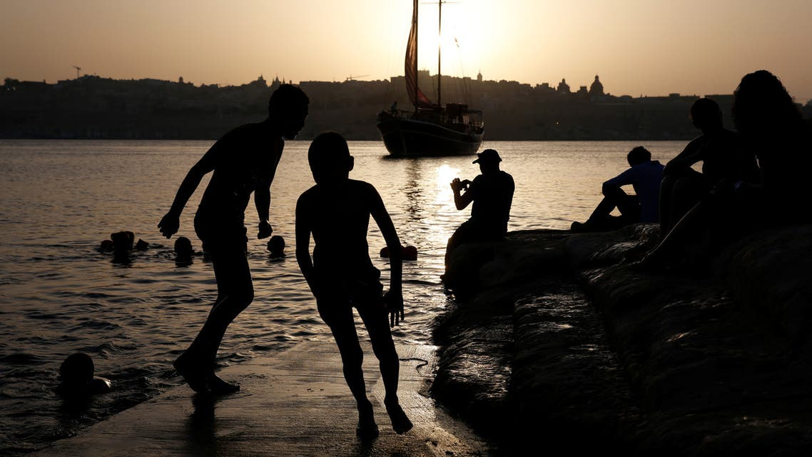 Children run on a swimming platformin Rinella Bay in the village of Kalkara, in Valletta's Grand Harbour, Malta, July 8, 2019. (Reuters)