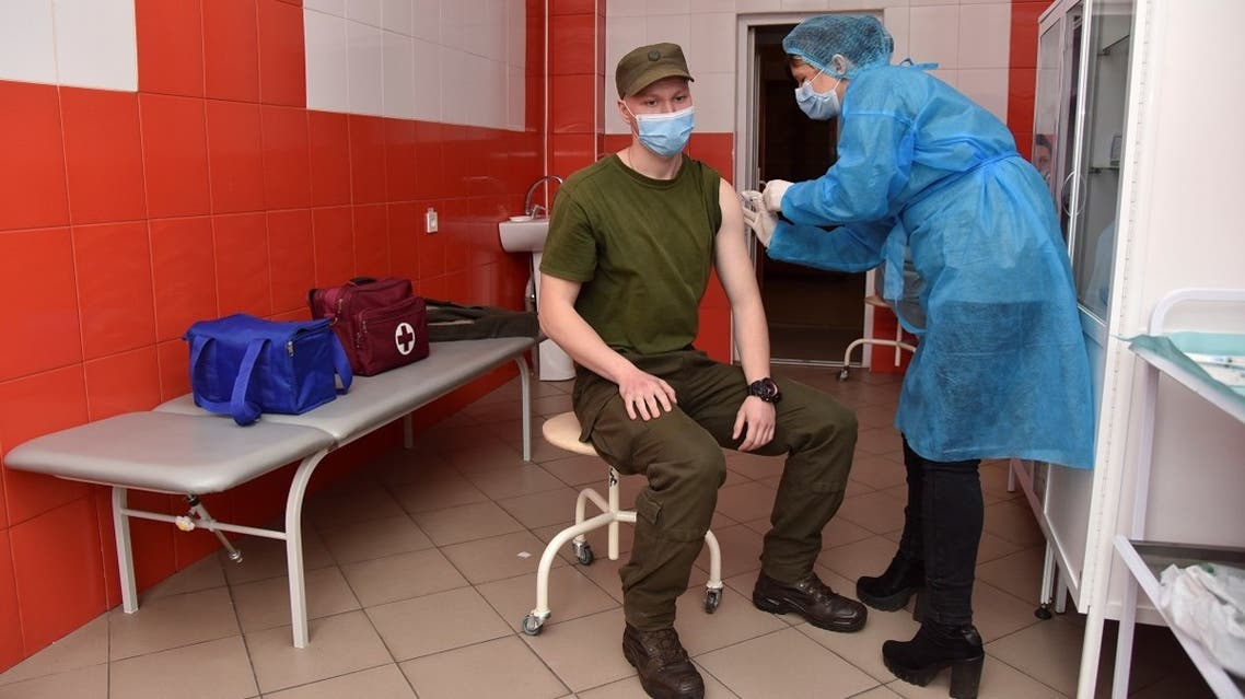 A member of the Ukrainian National Guard receives a dose of the Oxford University/AstraZeneca vaccine against the coronavirus in Lviv, Ukraine, on April 14, 2021. (Reuters)