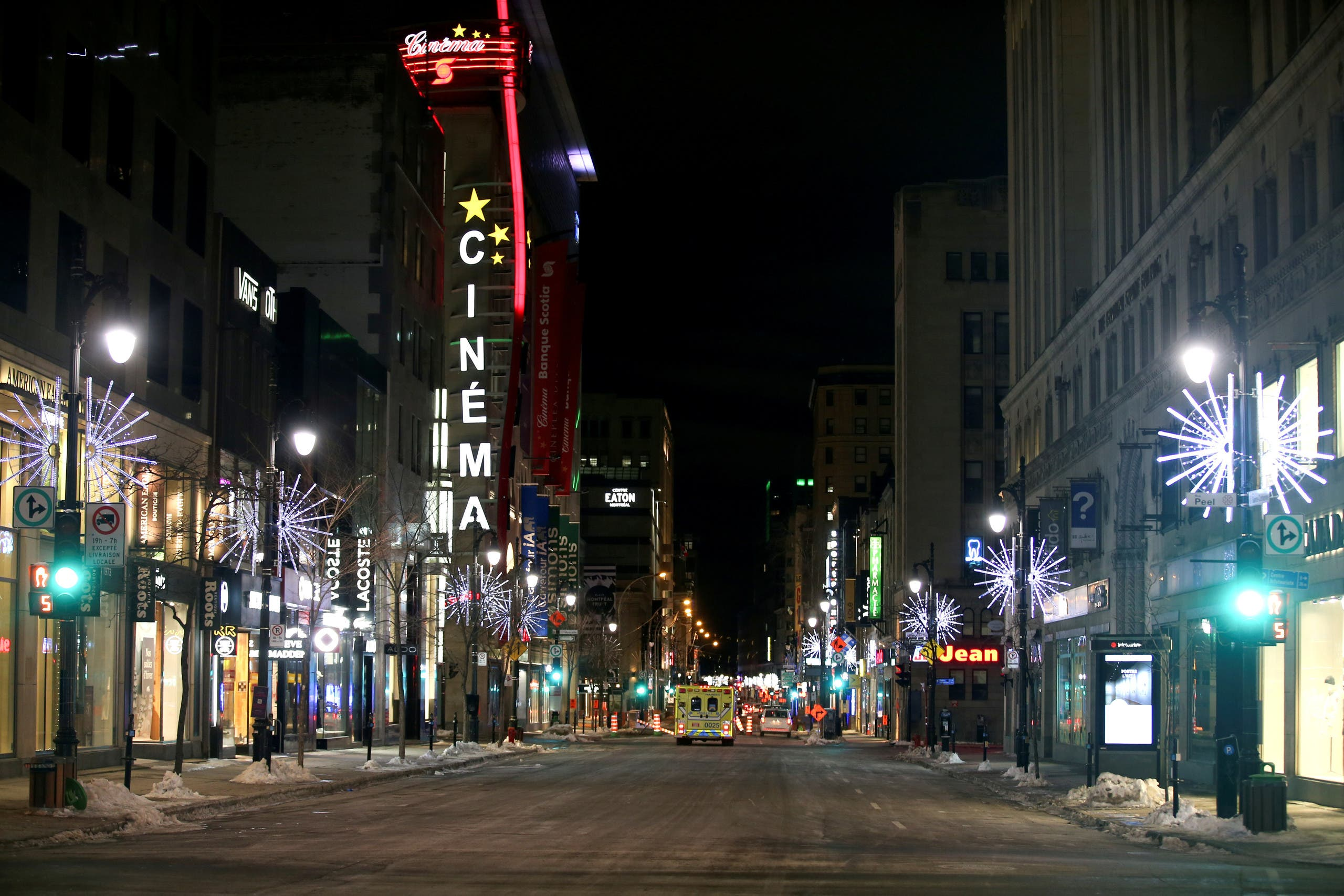 St. Catherine Street, a primary commercial artery of downtown Montreal is seen on the first night after a curfew is imposed by the Quebec government to help slow the spread of the coronavirus disease (COVID-19) pandemic in Montreal, Quebec, Canada January 9, 2021. (Reuters)