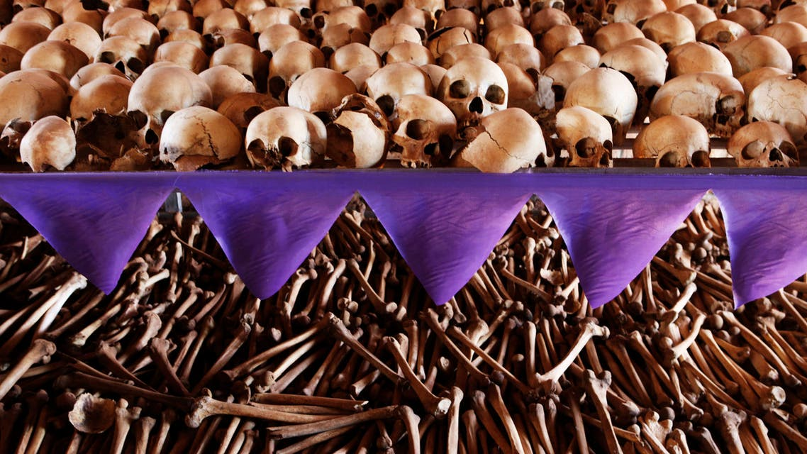 The skulls and bones of Rwandan victims rest on shelves at a genocide memorial inside the church at Ntarama just outside the capital Kigali, August 6, 2010. (Reuters)