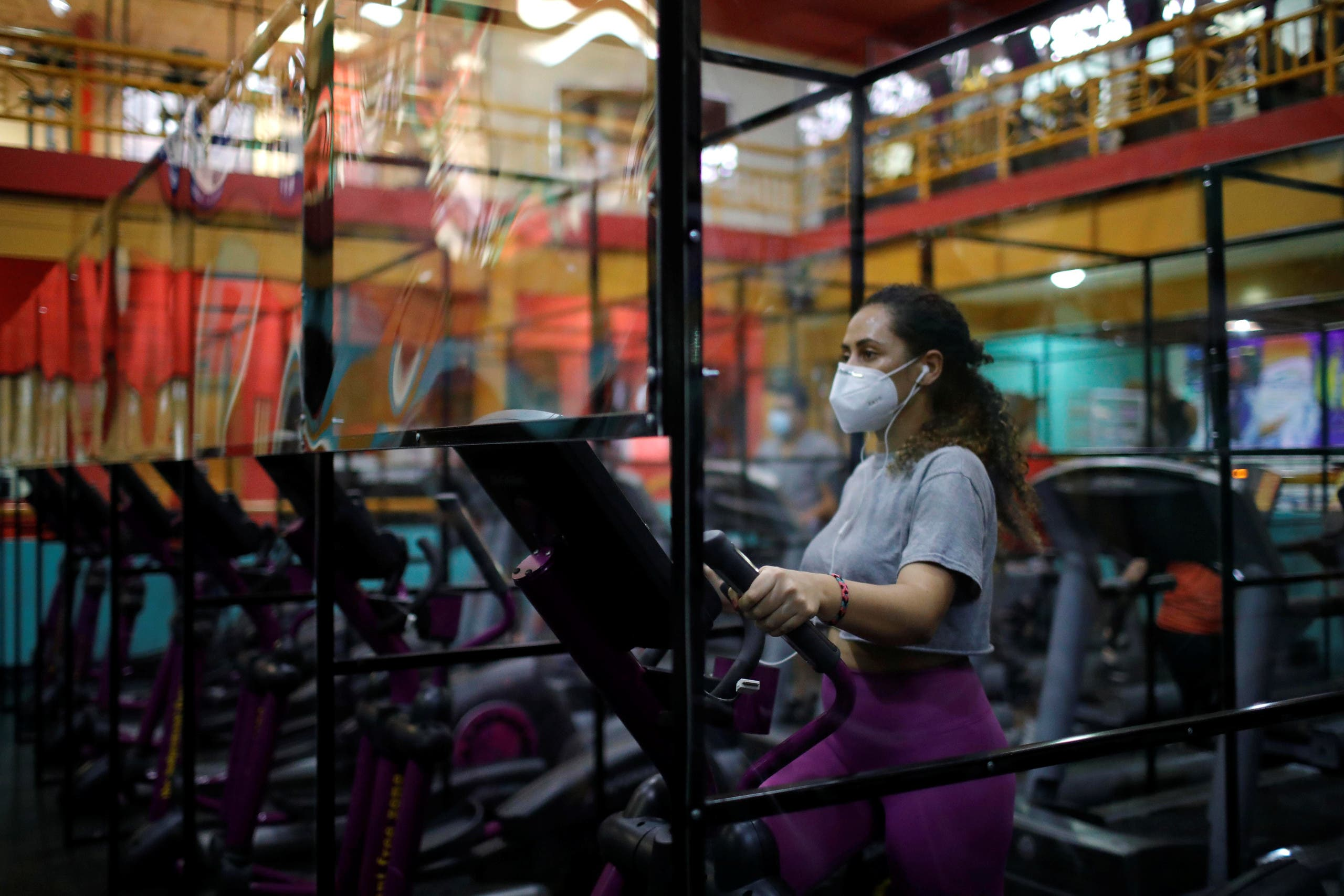 A woman exercises on a machine in Antiguo Cuscatlan, El Salvador. (Reuters)