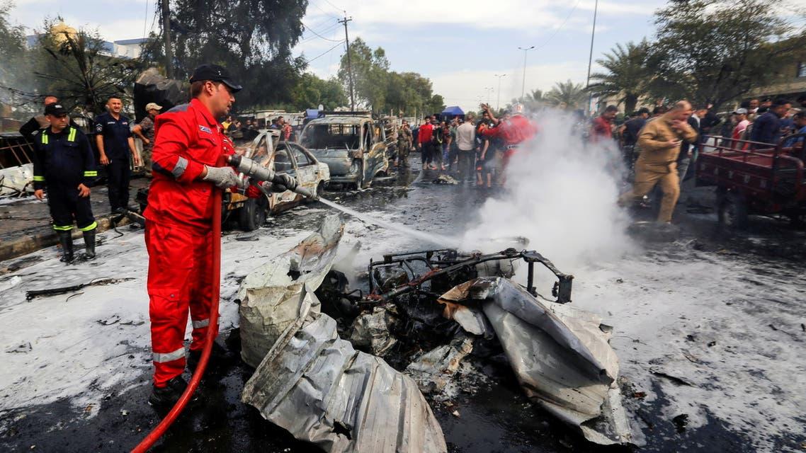 من موقع التفجير في مدينة الصدر ببغداد (أرشيفية- رويترز)