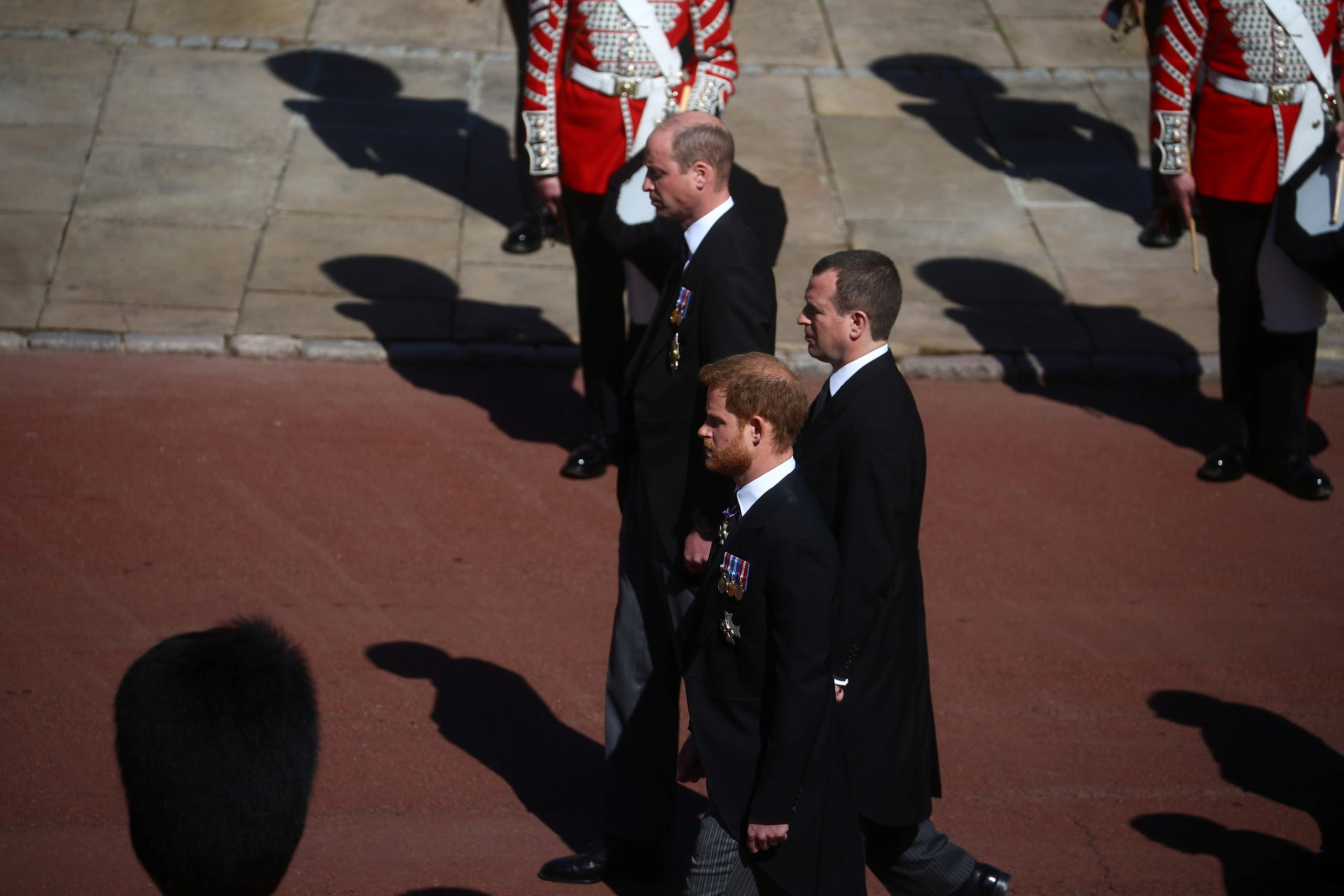 Britain's Prince Harry, Duke of Sussex, Peter Phillips and Britain's Prince William, Duke of Cambridge follow the hearse, a specially modified Land Rover, near St George's Chapel during the funeral of Britain's Prince Philip, husband of Queen Elizabeth, who died at the age of 99, on the grounds of Windsor Castle in Windsor, Britain, April 17, 2021. (Reuters)