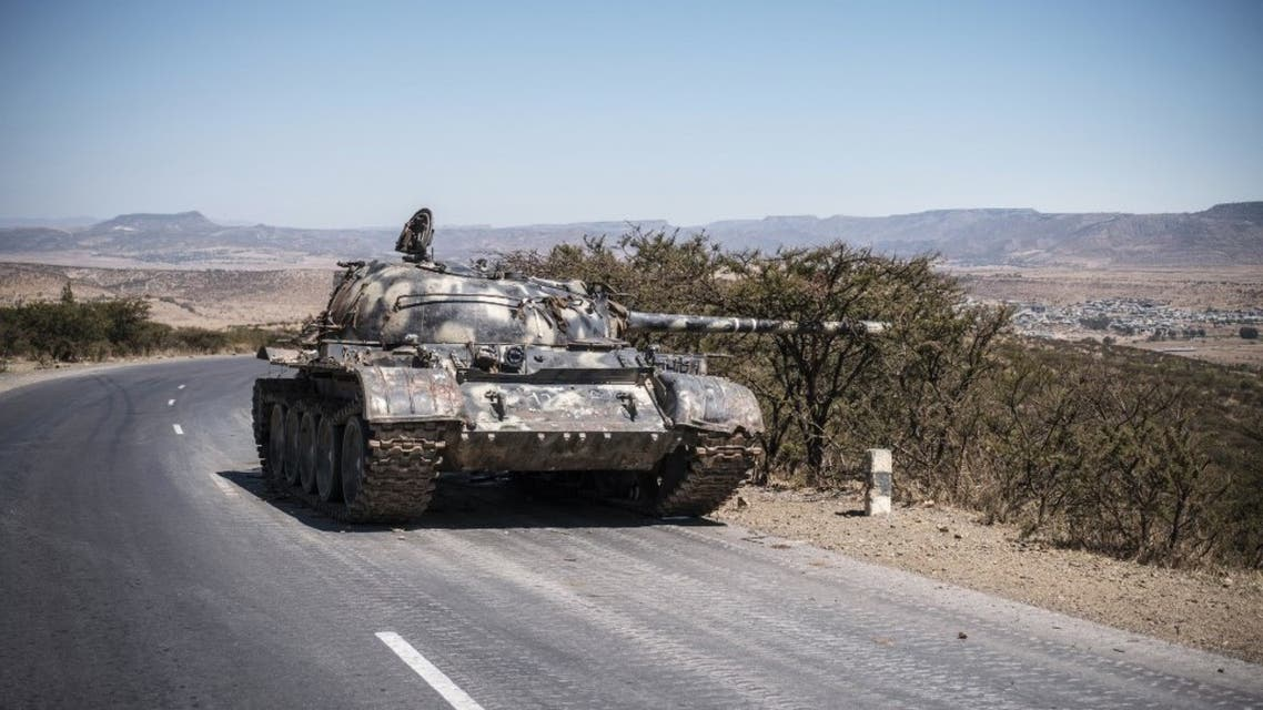 A damaged tank stands on a road north of Mekele, the capital of Tigray on February 26, 2021. (AFP)