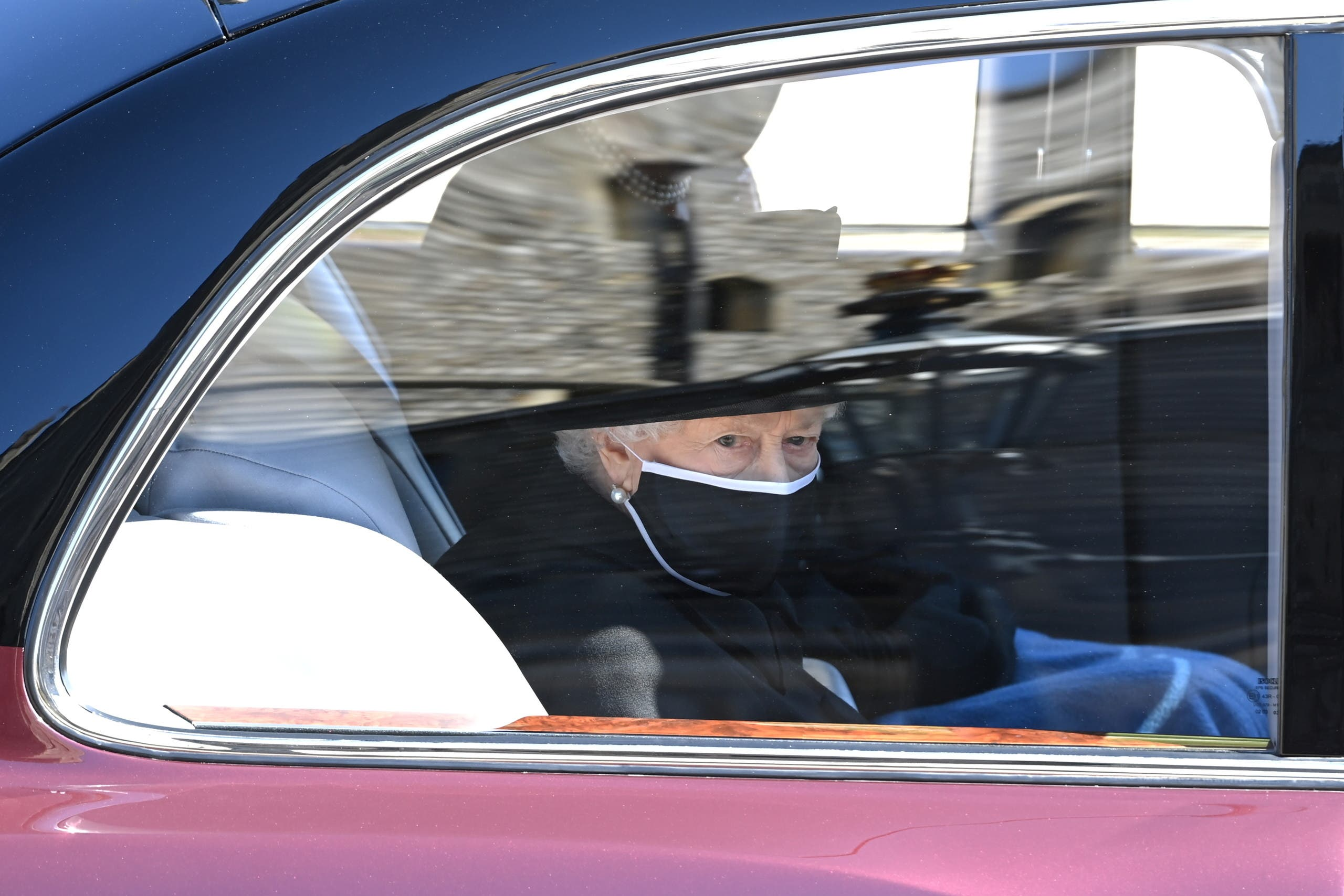 Britain's Queen Elizabeth attends the funeral of her husband, Britain's Prince Philip, who died at the age of 99, on the grounds of Windsor Castle in Windsor, Britain, April 17, 2021. (Reuters)