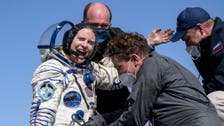 American and two Russians return to Earth from space station