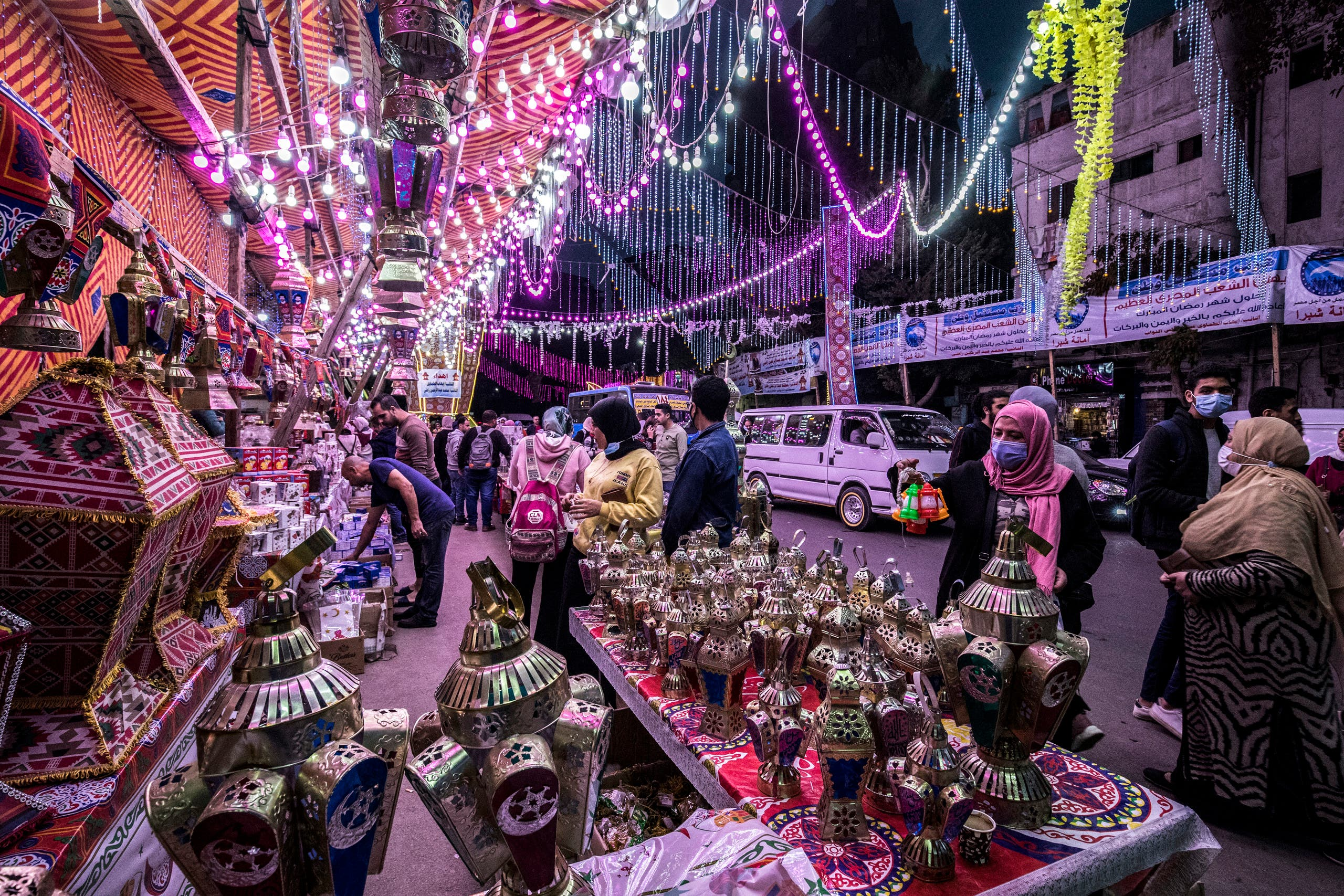 People shop from a stall selling Ramadan lanterns along a main street in the in the northern suburb of Shubra of Egypt's capital Cairo. (AFP)