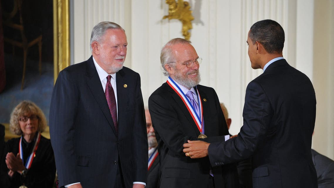 US President Barack Obama presents a National Medal of Technology and Innovation to John E. Warnock (C) and Charles M. Geschke (L) of Adobe Systems Inc. (AFP)