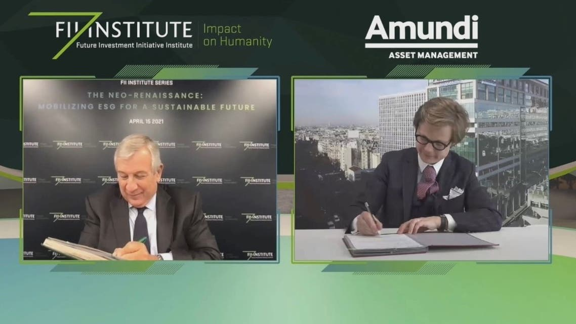 The FII Institute's Richard Attias (L) and Amundi's Jean-Jacques Barbéris sign an MoU to partner on ESG. (Supplied)