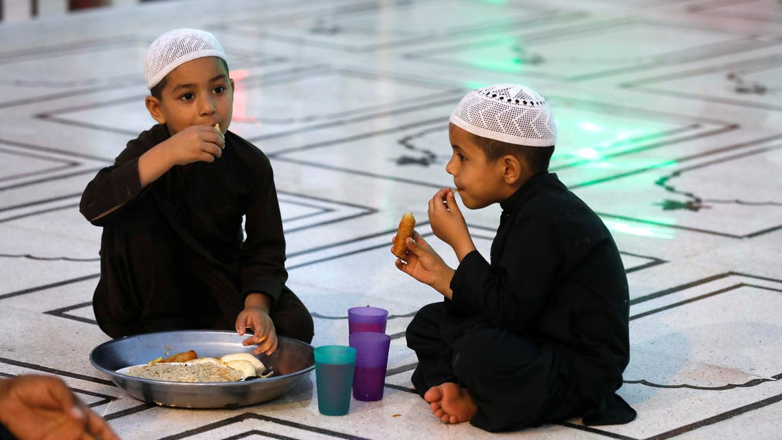 Boys have their Iftar (breaking fast) meal during the fasting month of Ramadan at a mosque in Karachi. (Reuters)