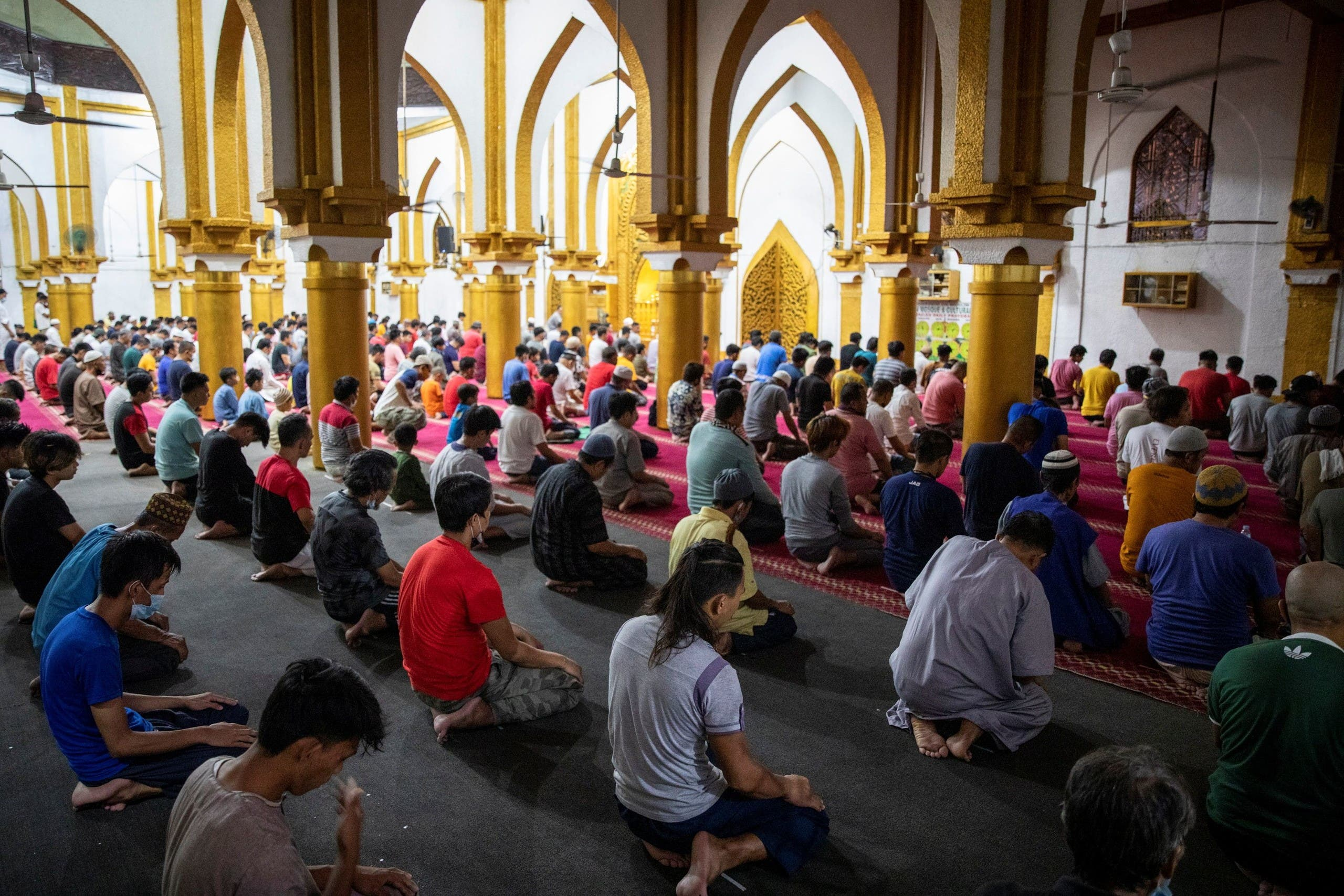 Filipino Muslim men attend prayers on the first day of Ramadan, amid the coronavirus disease (COVID-19) pandemic, at the Golden Mosque in Quiapo, Manila, Philippines. (Reuters)