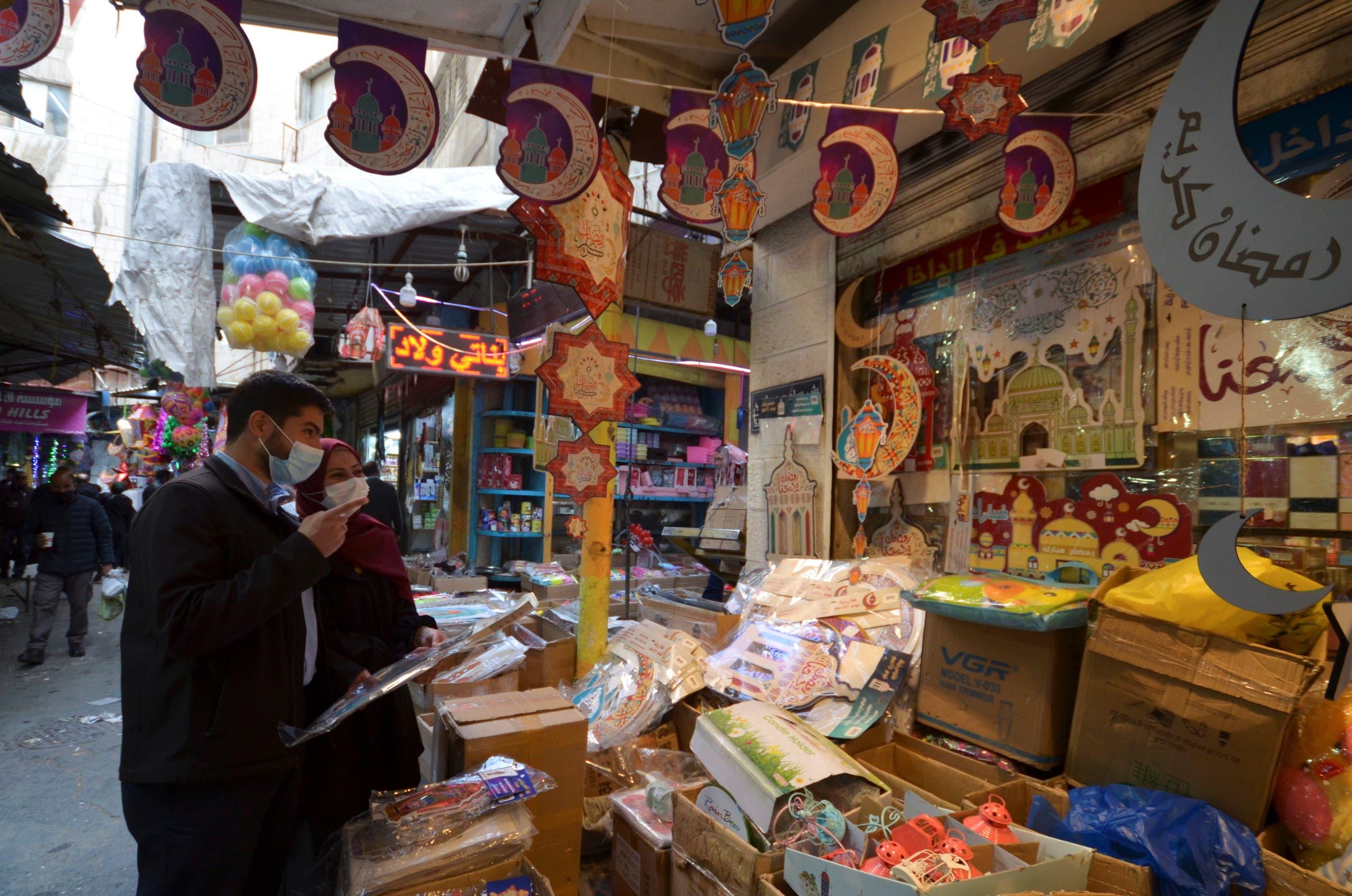 People shop for Ramadan decorations amid the coronavirus disease (COVID-19) pandemic, in Amman, Jordan. (Reuters)