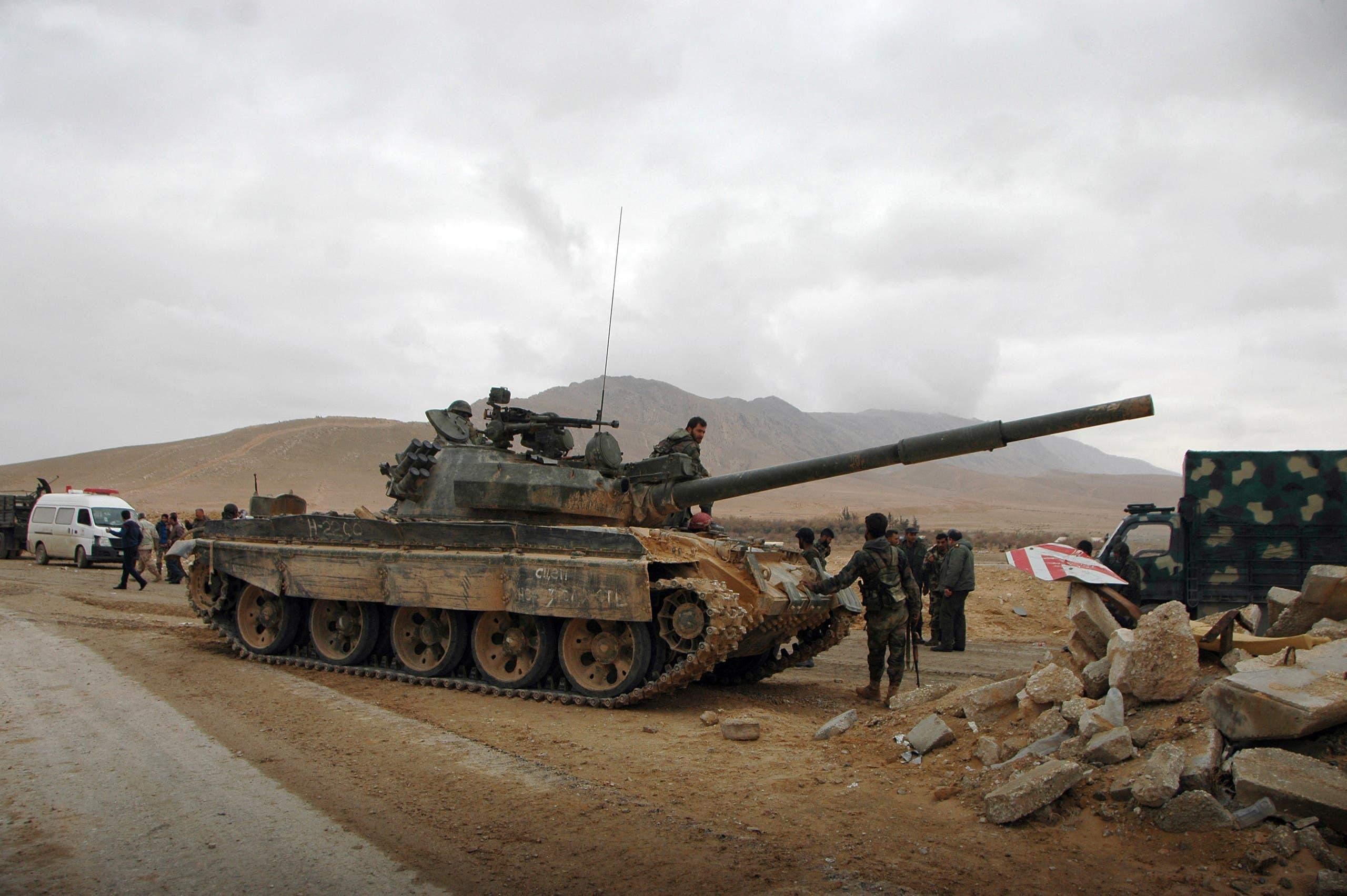 عناصر من قوات النظام السوري في محيط تدمر (أرشيفية)