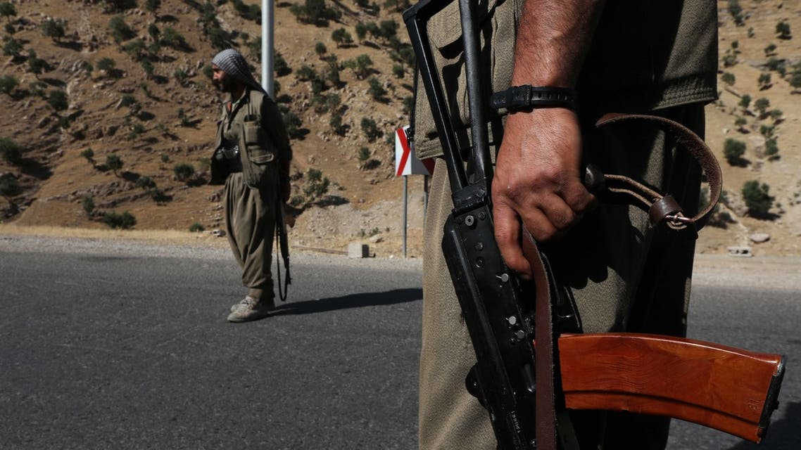A member of the Kurdistan Workers' Party (PKK) carries an automatic rifle on a road in the Qandil Mountains, the PKK headquarters in northern Iraq, on June 22, 2018. (AFP)