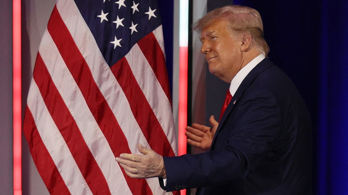 ORLANDO, FLORIDA - FEBRUARY 28: Former President Donald Trump embraces the American flag as he arrives on stage to address the Conservative Political Action Conference held in the Hyatt Regency on February 28, 2021 in Orlando, Florida. Begun in 1974, CPAC brings together conservative organizations, activists, and world leaders to discuss issues important to them. Joe Raedle/Getty Images/AFP