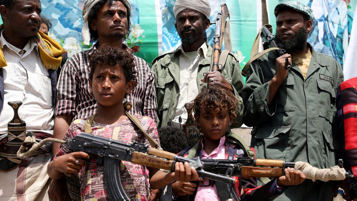 Boys from the Muhamasheen (marginalized) community hold weapons as they attend a pro-Houthi gathering at their neighborhood in Sanaa, Yemen 15, 2020. Picture taken July 15, 2020. REUTERS/Khaled Abdullah TPX IMAGES OF THE DAY